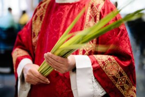 Why do we receive palms on Palm Sunday?