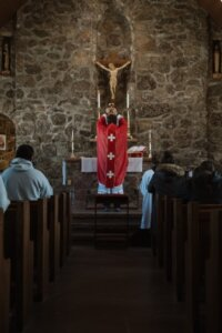 Why does the priest face the altar in the Latin Mass?