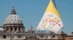 What do the parts of the Vatican flag symbolize?