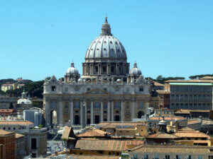 Why is St. Peter wearing a sling in his statue at the Vatican?